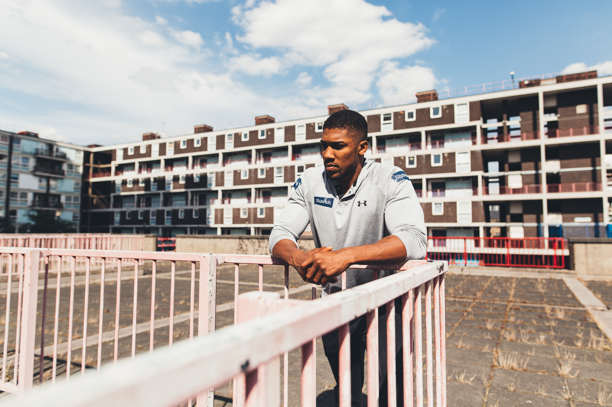 Anthony Joshua leaning on a railing
