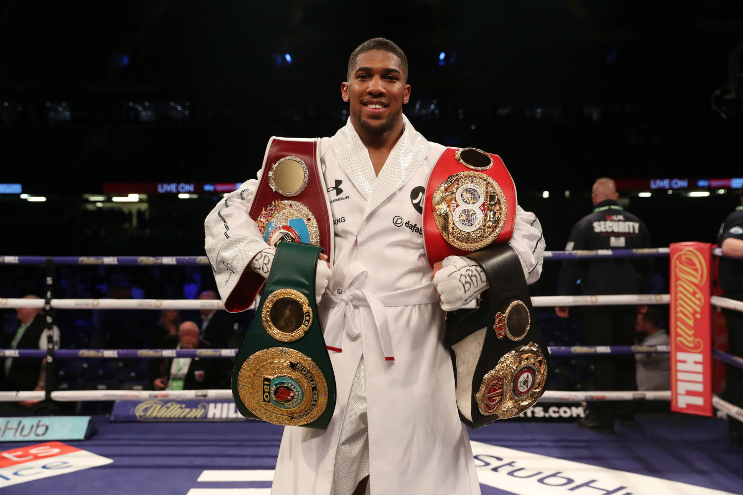 Anthony Joshua with his belts
