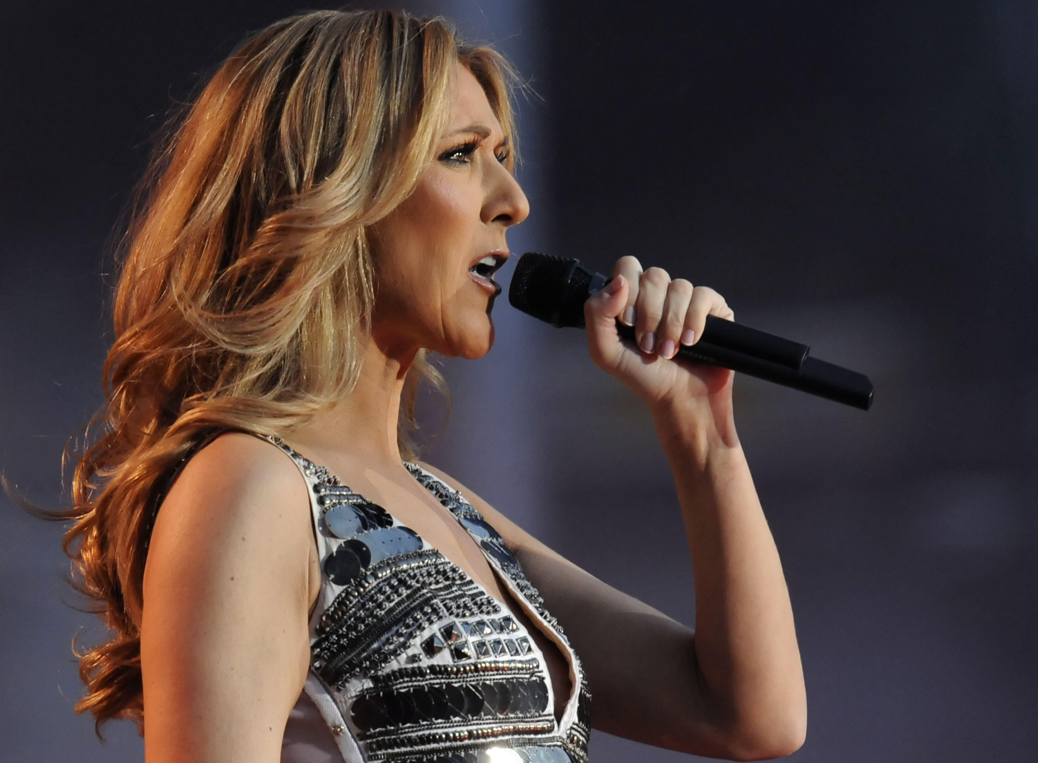 Celine Dion singing with a microphone