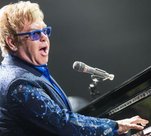 Elton John playing the piano