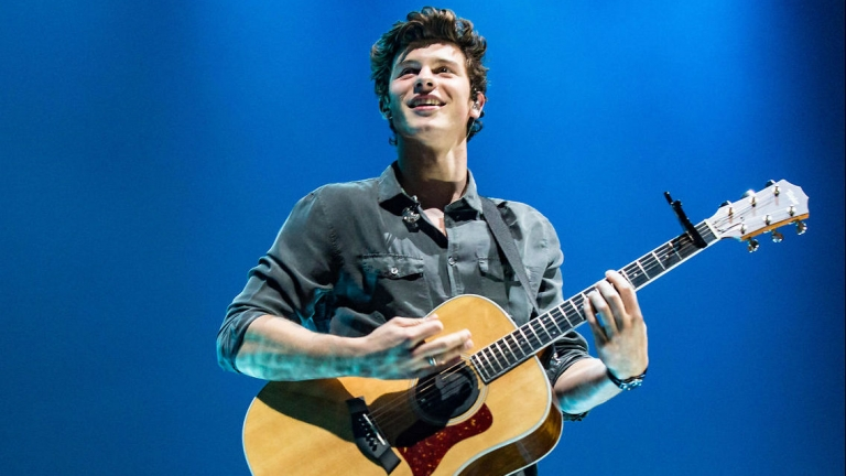 Shawn Mendes playing the guitar
