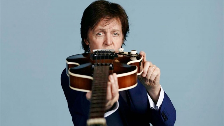 Paul McCartney with a guitar